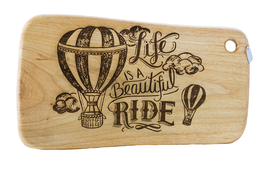 Inspirational message laser engraved onto a Camphor Laurel Cutting Board.