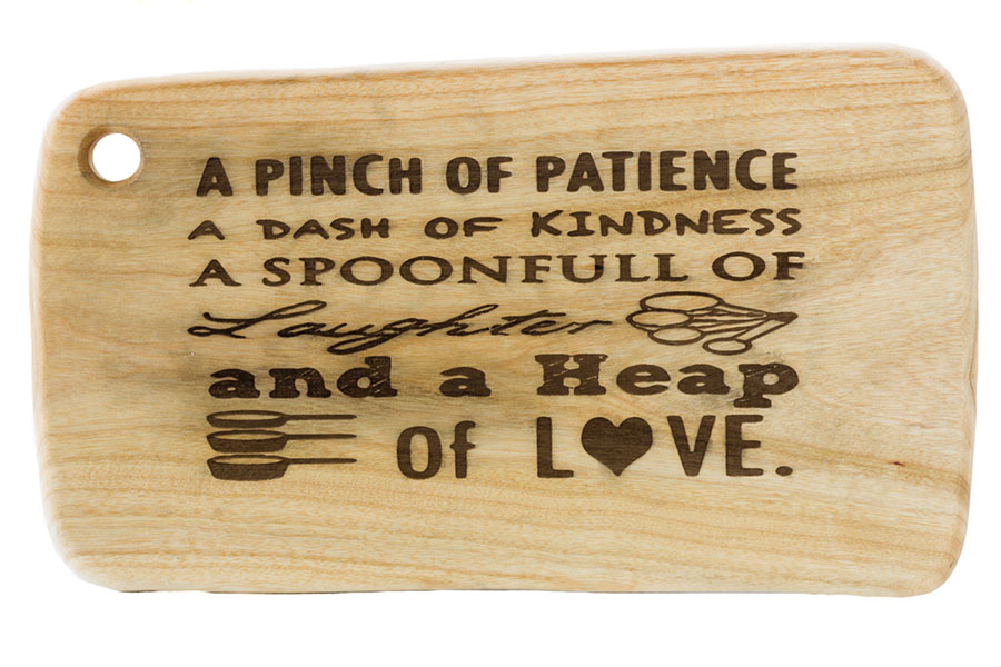 Australian cutting board with inspirational message.